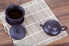 Chinese ceramic tea set on table Stock Photos