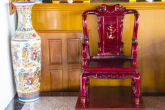 Chinese chair and vase. Chinese style wood chair and big vase Royalty Free Stock Photography