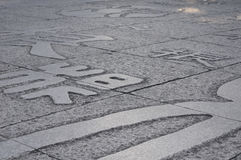 Chinese character Gen on stone pavers Royalty Free Stock Image