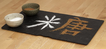 Chinese character sugar. Chinese character tang - sugar, being made of white and brown sugar, on black slate surface royalty free stock photography