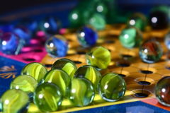 Chinese Checkers. A close up shot of a game of Chinese Checkers. The star shaped board is filled with colorful glass marbles Stock Photo