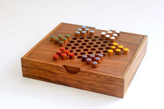 Chinese checkers colour pegs on a wooden board Stock Photo