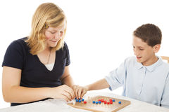 Chinese Checkers Game. Brother and sister playing a game of chinese checkers (this is a generic game, not a brand name). White background stock photos
