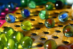 Chinese Checkers Game Board. A close up view of the marbles on a game of Chinese Checkers Royalty Free Stock Photography