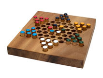 Chinese checkers wooden board isolated on white. Chinese traditional game checkers on wooden board isolated on white stock photography