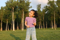 Chinese cheerful girl. The Chinese girl with cheerful smile Royalty Free Stock Images
