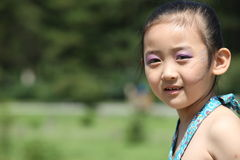 Chinese cheerful girl. The Chinese girl with cheerful smile Royalty Free Stock Image