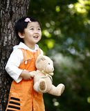Chinese cheerful girl. The Chinese girl with cheerful smile. With her lovely toy.This photograph was taken in her 26 months Royalty Free Stock Image