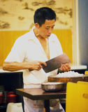 Chinese chef cutting onion Royalty Free Stock Images