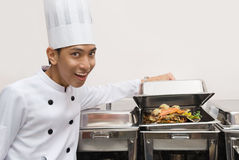 Chinese chef showing food Royalty Free Stock Images