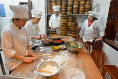 Chinese chefs prepare Dim sum dumpling Royalty Free Stock Image