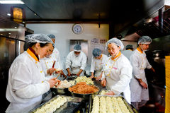 Chinese chefs prepare Dim sum dumpling Royalty Free Stock Photo
