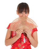 Chinese cheongsam female with fan Stock Images