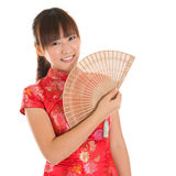 Chinese cheongsam girl with fan Royalty Free Stock Photo