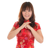 Chinese cheongsam girl greeting Stock Image