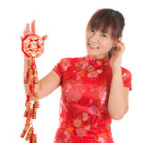 Chinese cheongsam girl holding fire crackers Royalty Free Stock Photography