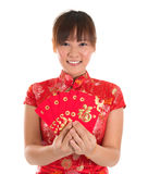 Chinese cheongsam girl holding red packets Stock Photography