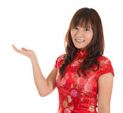 Chinese cheongsam girl showing blank space Royalty Free Stock Photos