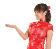 Chinese cheongsam girl showing empty palm Royalty Free Stock Photos