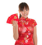 Chinese cheongsam girl showing red packets Stock Photos