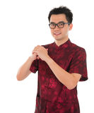 Chinese cheongsam male greeting Stock Image