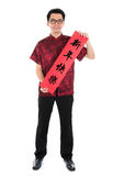 Chinese cheongsam male holding couplet Royalty Free Stock Photography