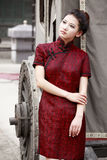 Chinese cheongsam model. Standing beside the carriage Stock Image