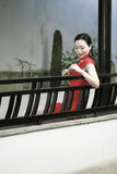 Chinese cheongsam model in Chinese classical garden Stock Image