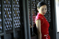Chinese cheongsam model in Chinese classical garden Stock Images