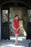 Chinese cheongsam model in Chinese classical garden Stock Photo