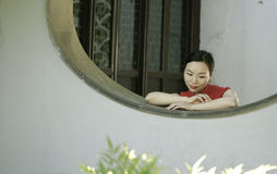 Chinese cheongsam model in Chinese classical garden Stock Photos