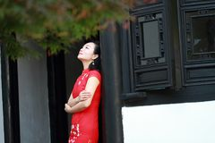 Chinese cheongsam model play in a famous garden Stock Images