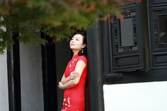 Chinese cheongsam model play in a famous garden Stock Photo