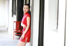 Chinese cheongsam model play in a famous garden Stock Image