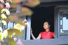 Chinese cheongsam model Stand by the window Stock Images