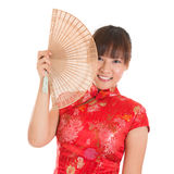 Chinese cheongsam woman with fan Stock Photo