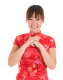 Chinese cheongsam woman greeting Royalty Free Stock Photo