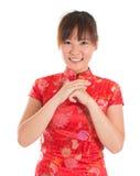 Chinese cheongsam woman greeting Royalty Free Stock Photo