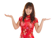 Chinese cheongsam woman showing blank space Stock Photo