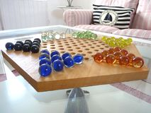 Chinese chequers board. On a glass coffee table Royalty Free Stock Image