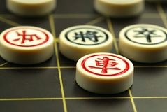 Chinese chess. Game board and pieces with shallow dof Royalty Free Stock Photo