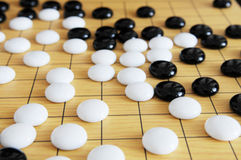 Chinese chess pieces on board Stock Image