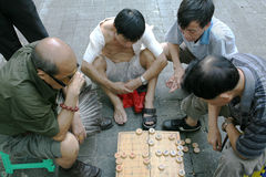 Chinese chess players. Asian players playing a strategic board game like Chinese Chess, called Xiangqi in Beijing China Royalty Free Stock Photos