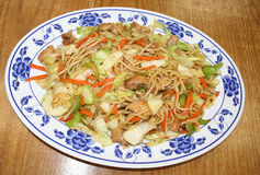Chinese Chicken, mushroom, pea-pod Chow Mein. Savory combination of noodles blended with stir fried chicken and vegtables and reduced sauce Stock Photos