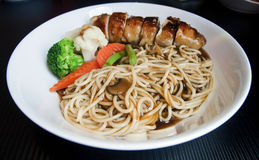 Chinese Chicken Noodles. On white plate stock photos