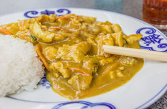 Chinese chicken in peanut sauce, served with rice Stock Photo