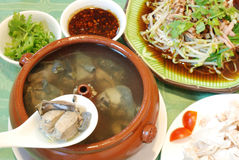 Chinese chicken pot course. A Yunnan meal course as chicken pot, sliced cold spicy pork, cold meat and cold bean sprout mixed wtih hot sauce Stock Images