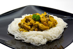 Chinese chicken with rice noodles. Chinese chicken with rice noodles on black plate Stock Images