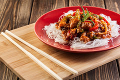 Chinese chicken with rice noodles Stock Photo
