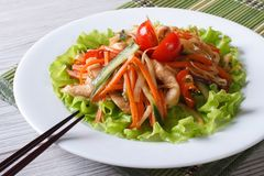 Chinese chicken salad with roasted vegetables, horizontal stock photo